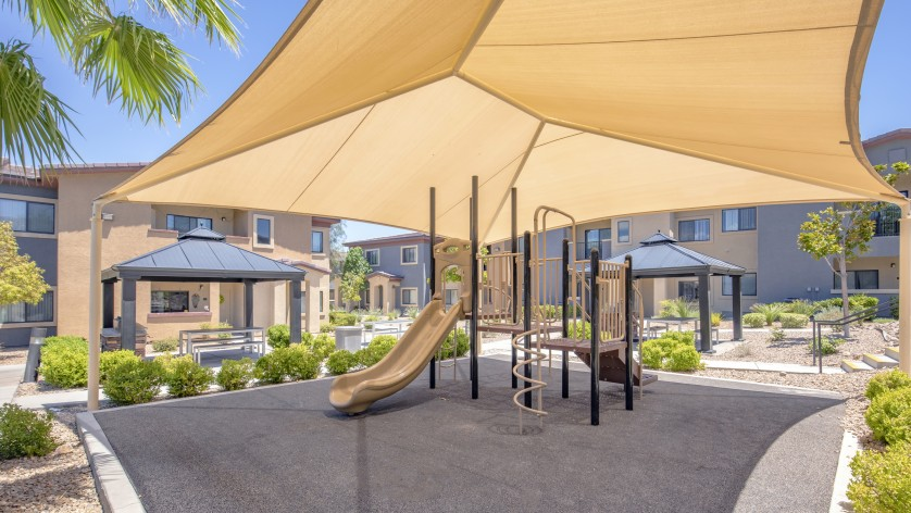 Image of Playground with sun awning for The Edge at Traverse Pointe Apartments