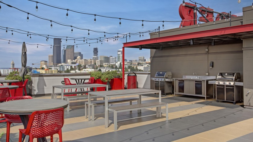 Image of Rooftop Deck with BBQ Area, Outdoor TV and Lounge Space with Firepit for Pratt Park Apartments