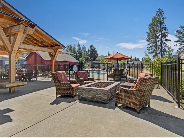 Image of Outdoor Lounge with Fireplace for Seasons Apartments at Farmington Reserve