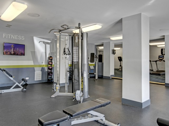 Image of Fitness Center with Free Weights for The Grove at City Center Apartments