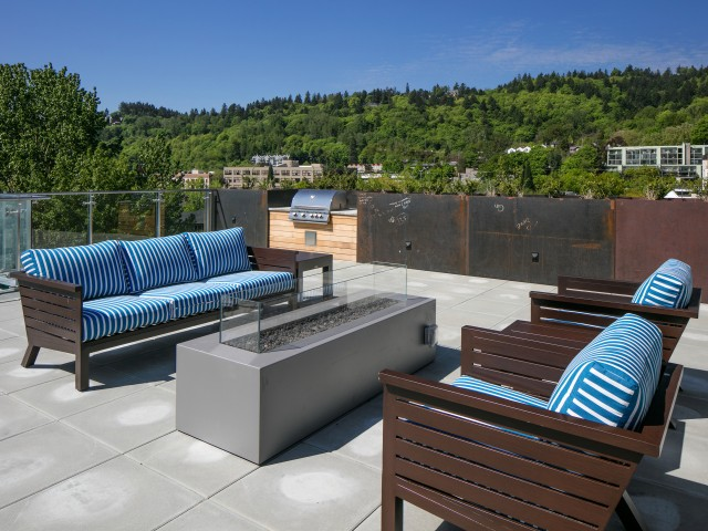 Image of Rooftop Terrace with Fire Pit, Gas BBQs and Outdoor TV for Sanctuary Apartments