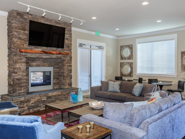 Image of Resident Clubhouse with Fireplace Lounge for Outlook at Pilot Butte Apartments