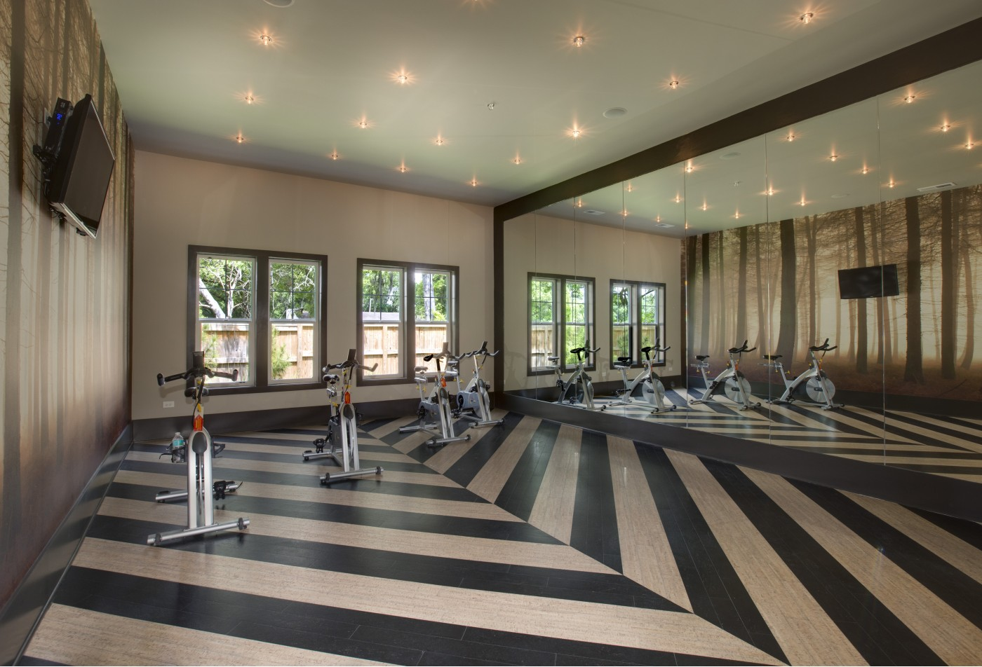 Photo of cardio exercise room with fitness bikes.