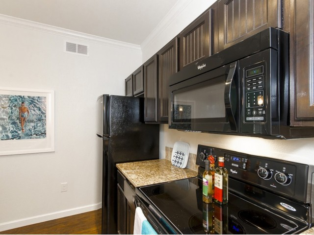 Image of Designer Kitchen Cabinets with Whirlpool® Black Appliances for The Estates Woodland