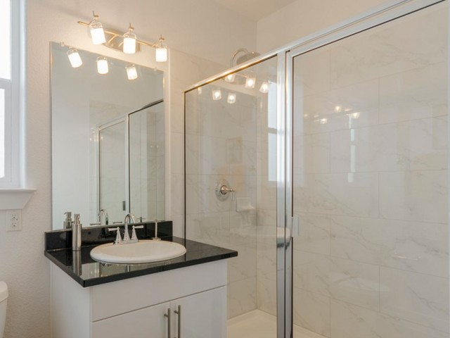 Image of Separate Stand-Up Showers with Rainwater Showerheads & Designer Plumbing Fixtures* for The Towers Seabrook