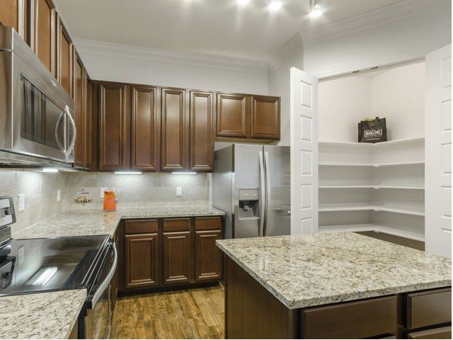 Image of Spacious Walk-in Pantries with Built-in Shelves for The Mansions of Wylie Active Adult Community