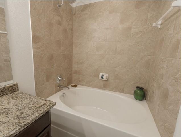 Image of Real Porcelain Tile Master Bath Surround & Kitchen Backsplash for The Mansions of Wylie Active Adult Community