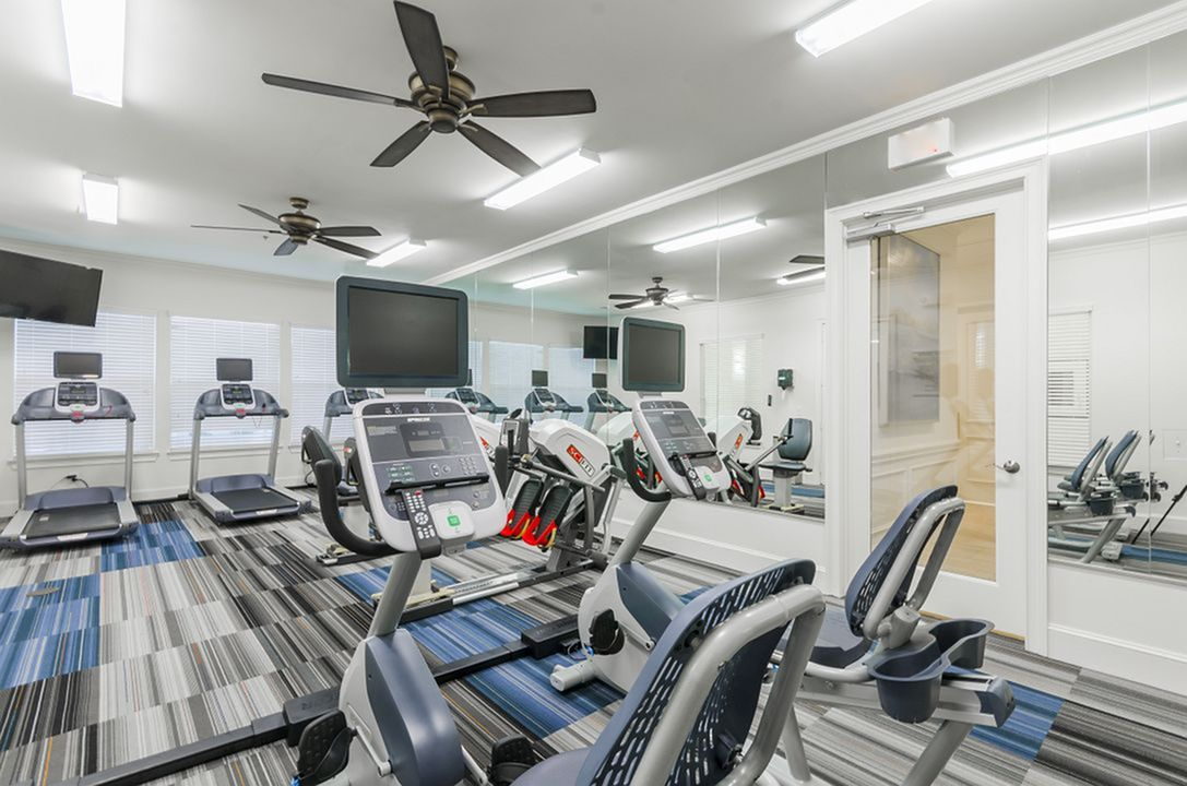 Image of 24/7 High-Tech Fitness Center with Cardio Theater for The Mansions of Wylie Active Adult Community