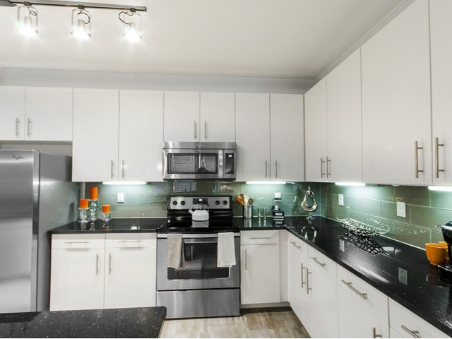 Oversized Custom Kitchen Cabinets & Modern Glass Tile Backsplashes