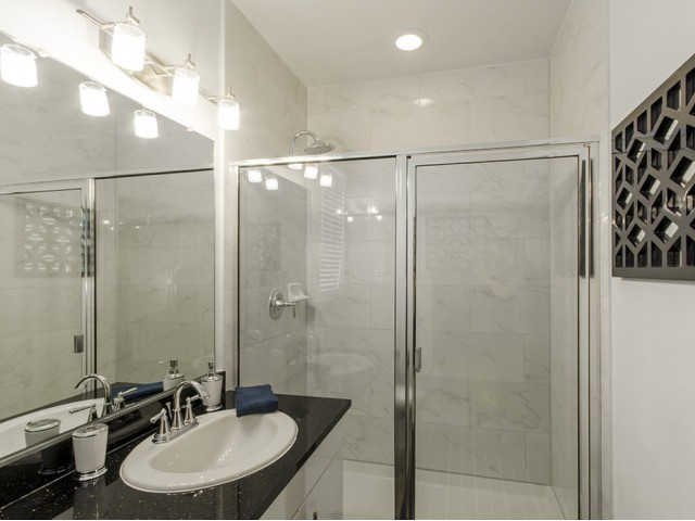 Separate Stand-Up Showers with Rainwater Showerhead & Upgraded Plumbing Fixtures*