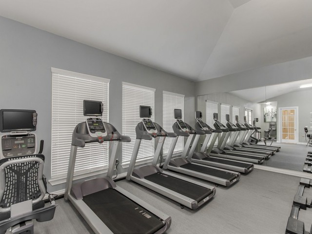 24/7 Fully-Equipped, High-Tech Fitness Center with Cardio Theater, Free Weights & Training Stations