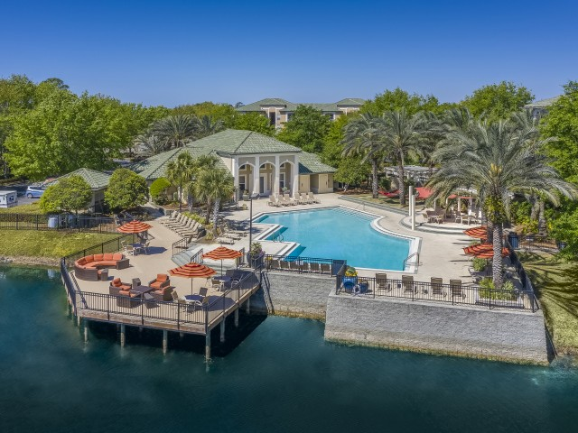 Image of Resort-Style Swimming Pool with Nature Pond Views for Legacy on the Bay