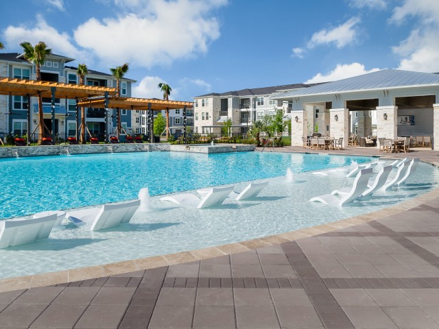 Image of Luxury lounge pool with in-water tanning deck for Sapphire Bay