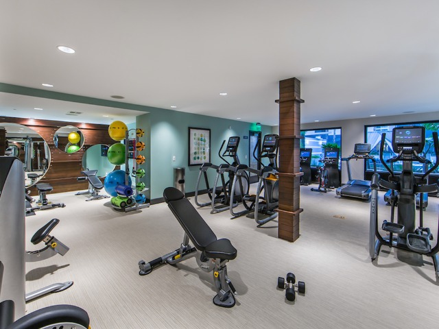 Club-style fitness center with private TV\'s on cardio equipment and complete strength training stations