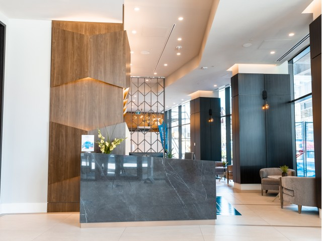 An expansive, luxury apartment community lobby