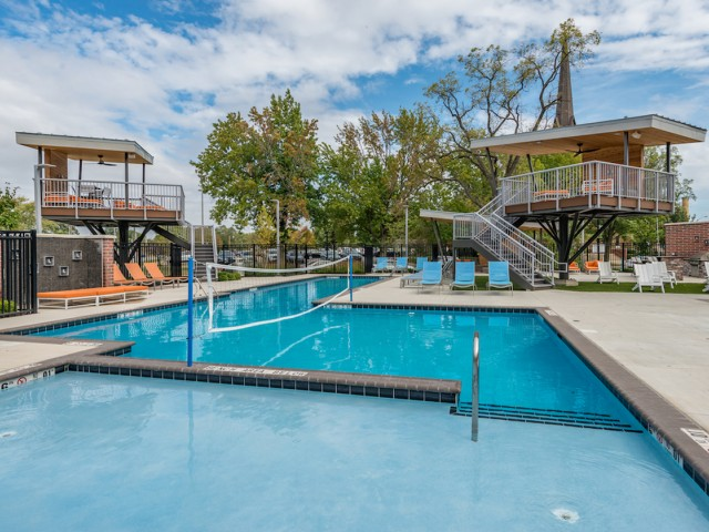 Image of Resort Style Swimming Pool w/ Tree Houses for Latitude
