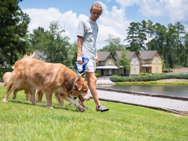 Residents Playing with their Pets | The Cottages of Hattiesburg | Student Apartments In Hattiesburg MS
