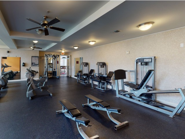 Fitness Center with Free Weights | The Quarters | Student Housing In Lafayette LA