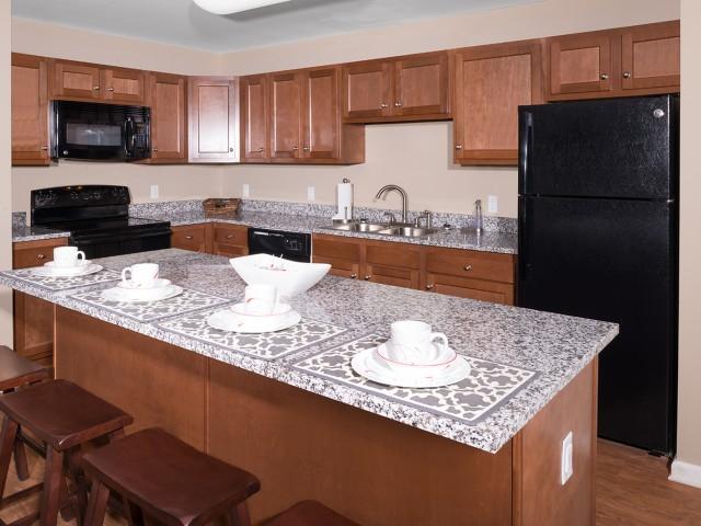 Cherry Cabinets & Luna Granite Countertops | University Hills | Toledo OH Student Apartments