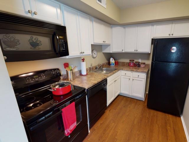 Black-on-Black Appliances | Kitchen | University Village | Apartments In Carbondale IL
