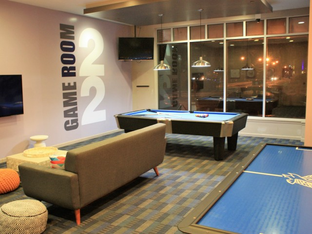 Game center with pool table and arcade   22 Exchange   Apartments Near University Of Akron