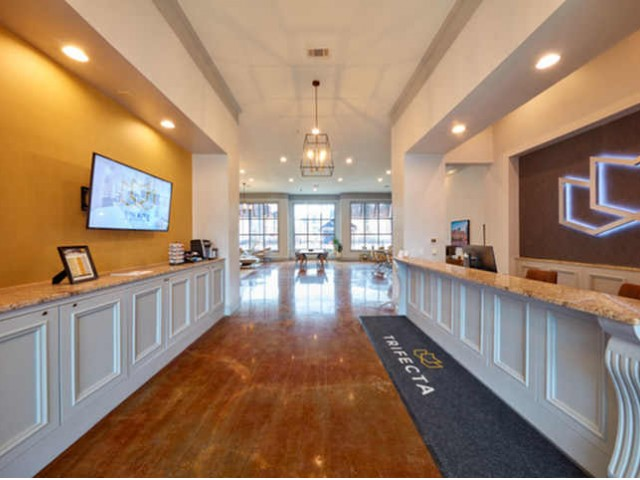 Leasing desk for on-site management at Trifecta Apartments | Louisville, KY Apartments