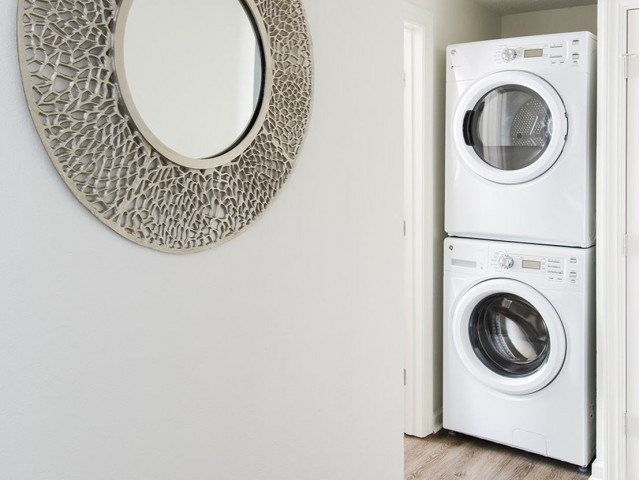 Stacked washer and dryer in apartment at The Flatts Salisbury | Apartments In Salisbury, MD.