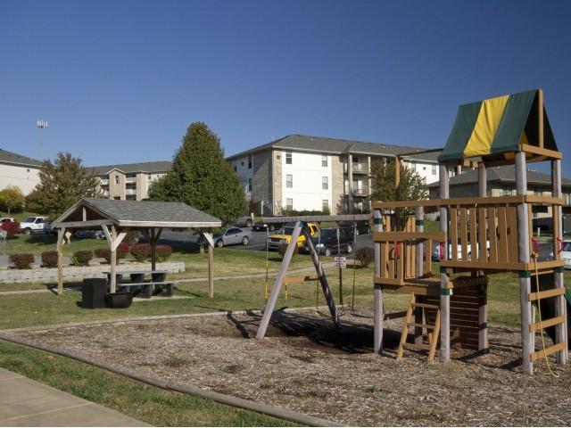 Playground Slide Swings Outside Lakewood Village