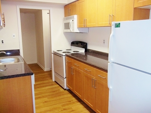 Residents Dining in the Kitchen | Apartment Homes In King of Prussia | Gulph Mills Village Apartments