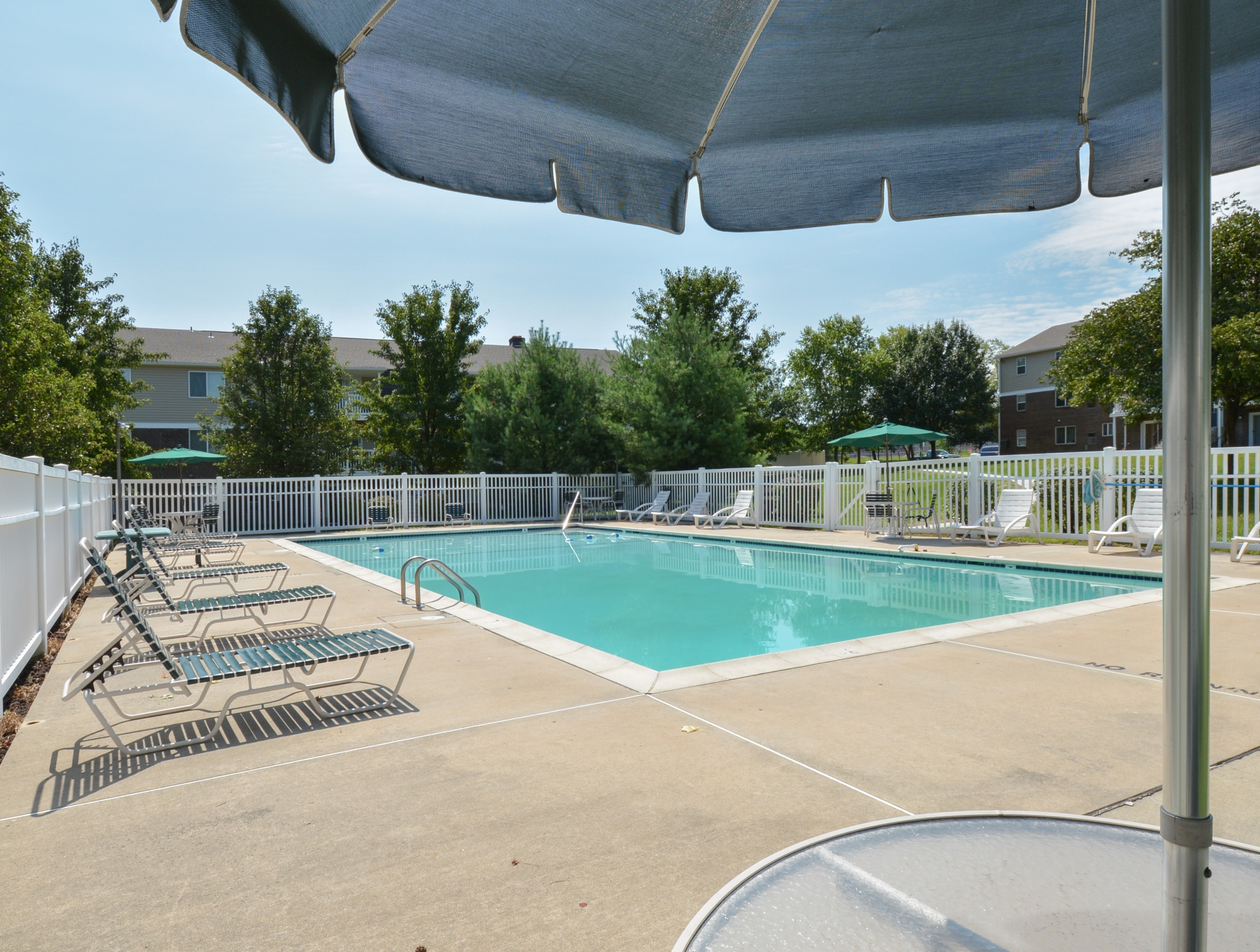 Glen Eagle Village Swimming Pool with Umbrella Shade | Newark Apartments Near DE