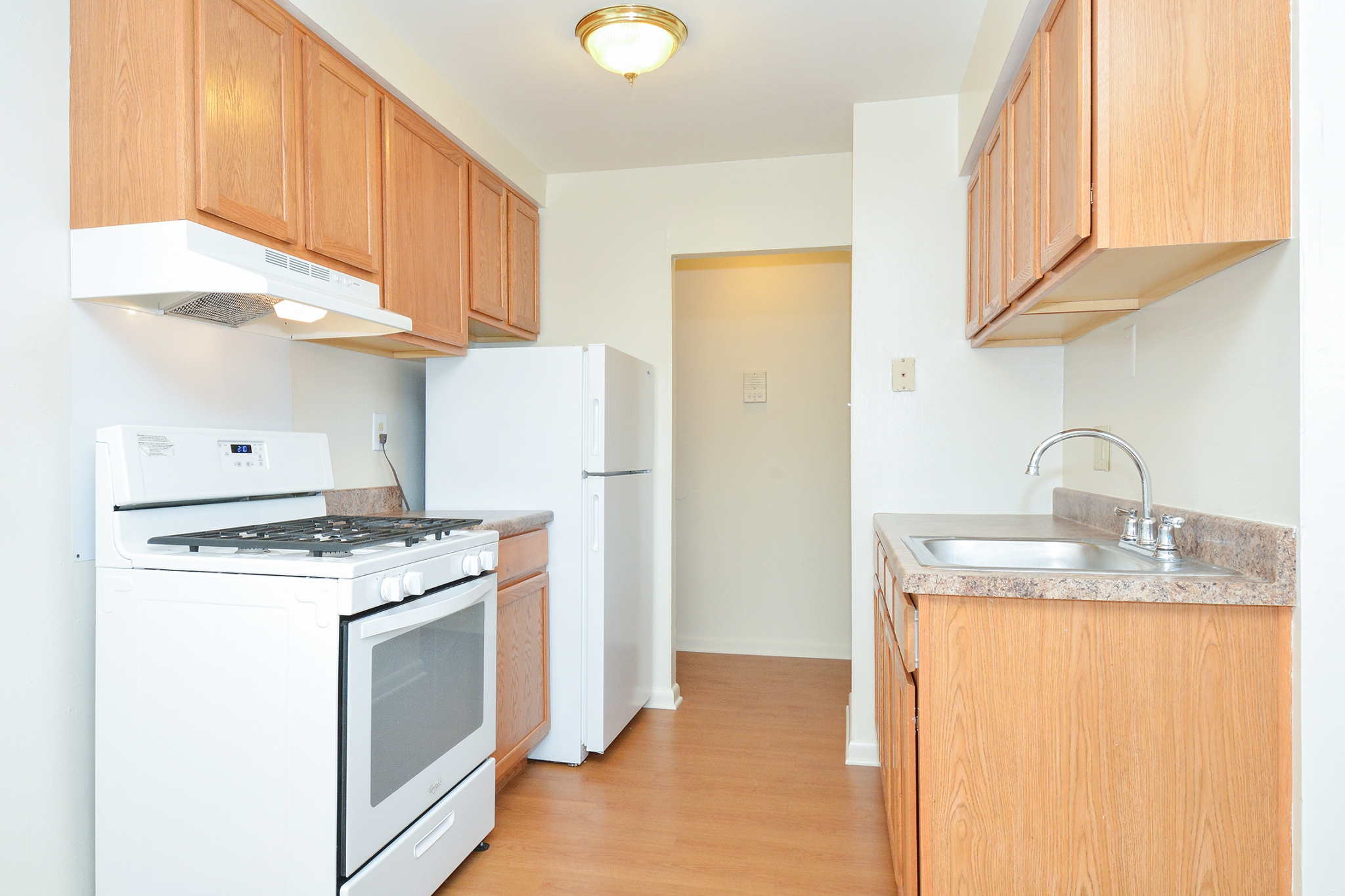 Newport Village Sample Kitchen with Brown Countertops and White Appliances | Levittown PA Apartments