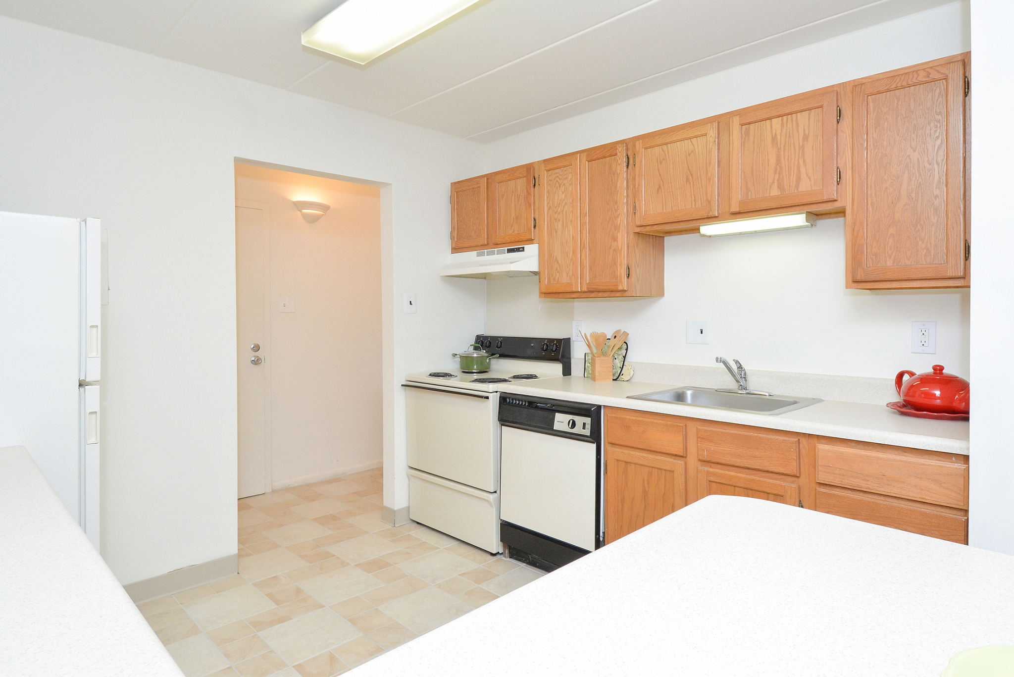 Fairway Park Sample Kitchen with Brown Cabinets and White Appliances | Apartments Near Wilmington DE