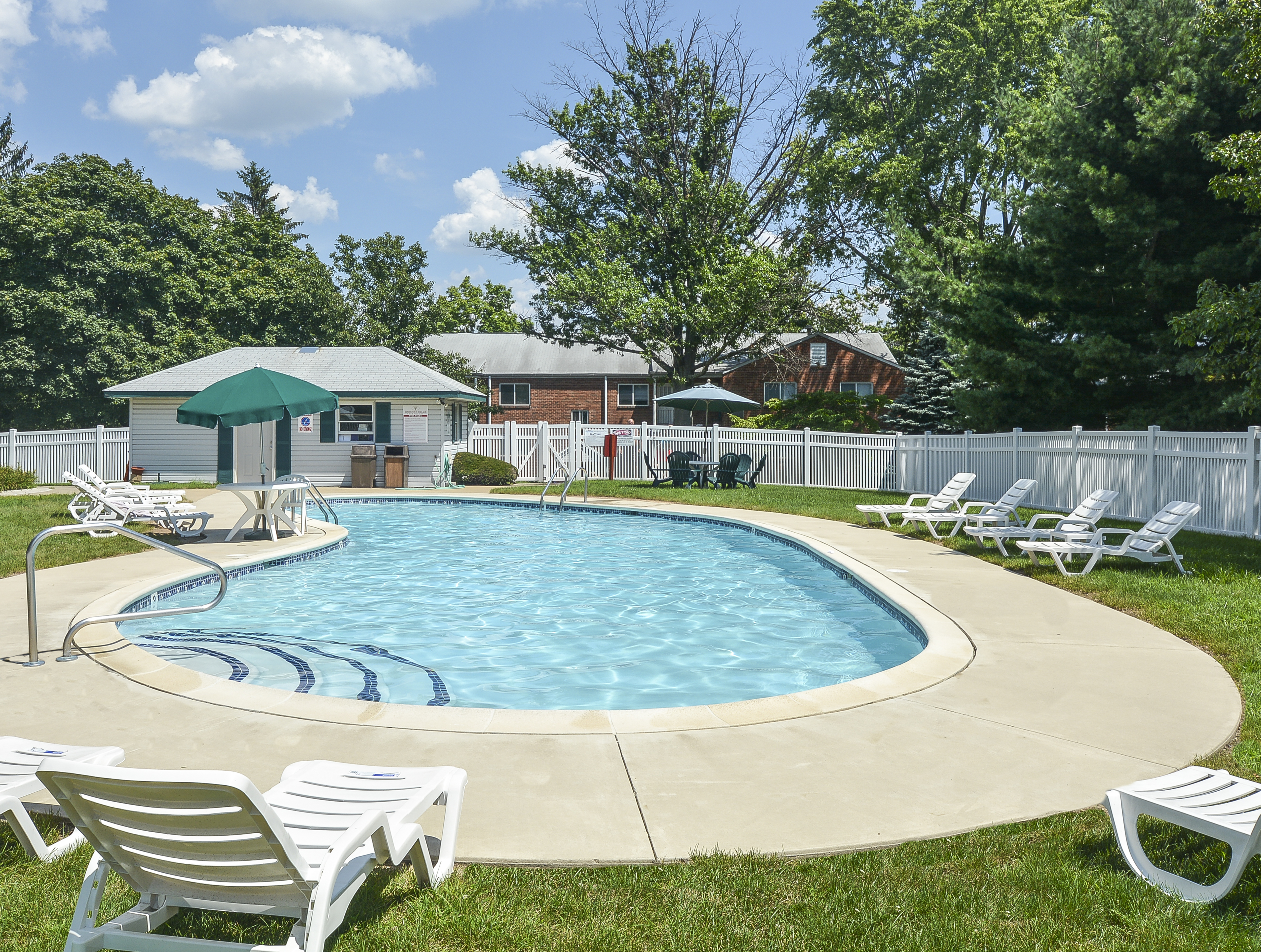 Jamestown Village Swimming Pool with White Chairs | Willow Grove, PA Apartments
