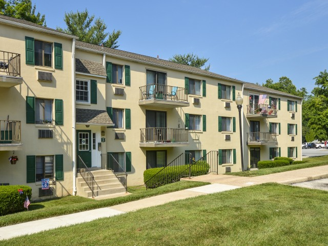 Norwood House Residential Building with Green Shutters and Balconies | Apartments In Downingtown