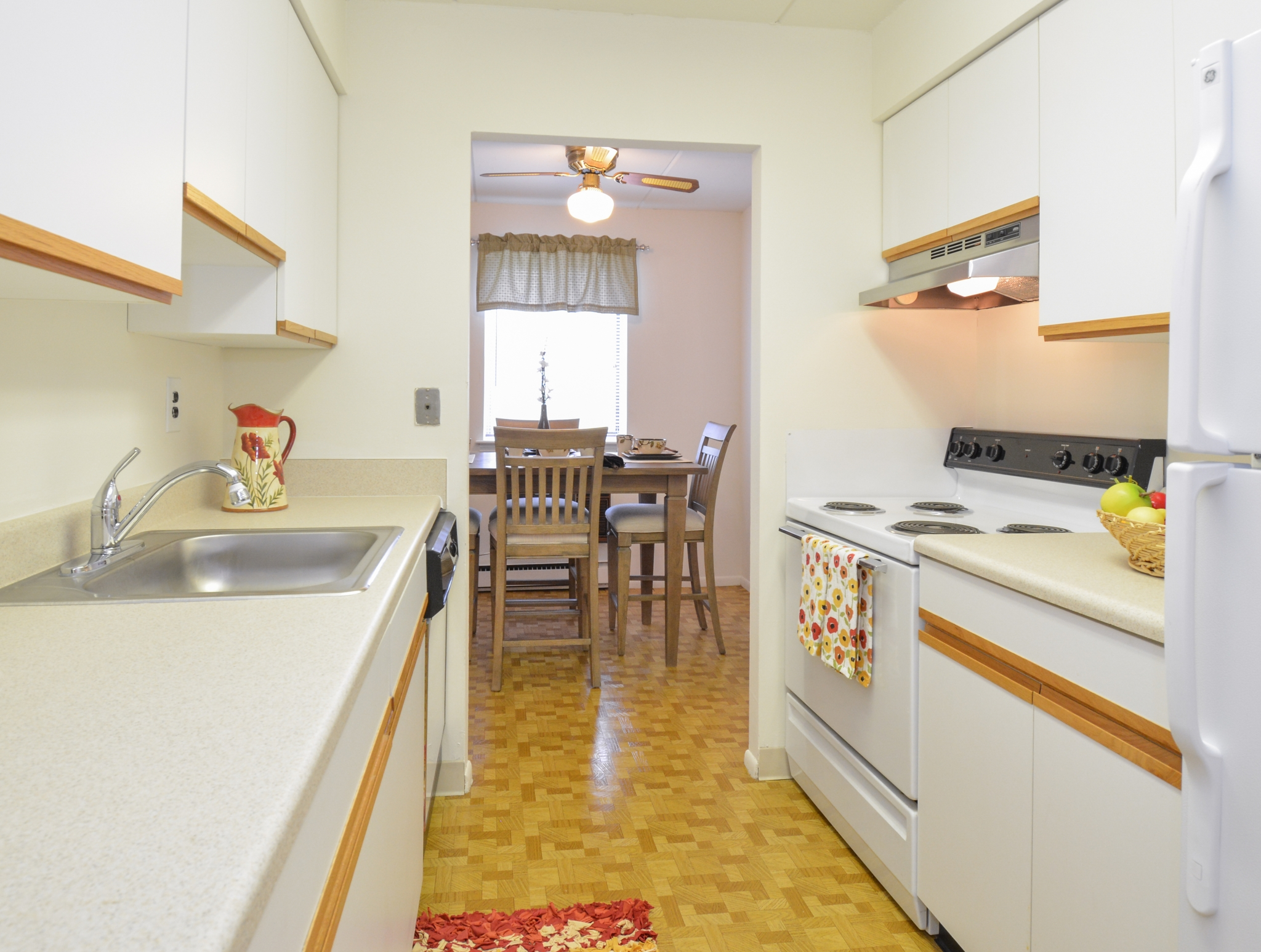 Norwood House Sample Kitchen with White Appliances | Apartments In Downingtown