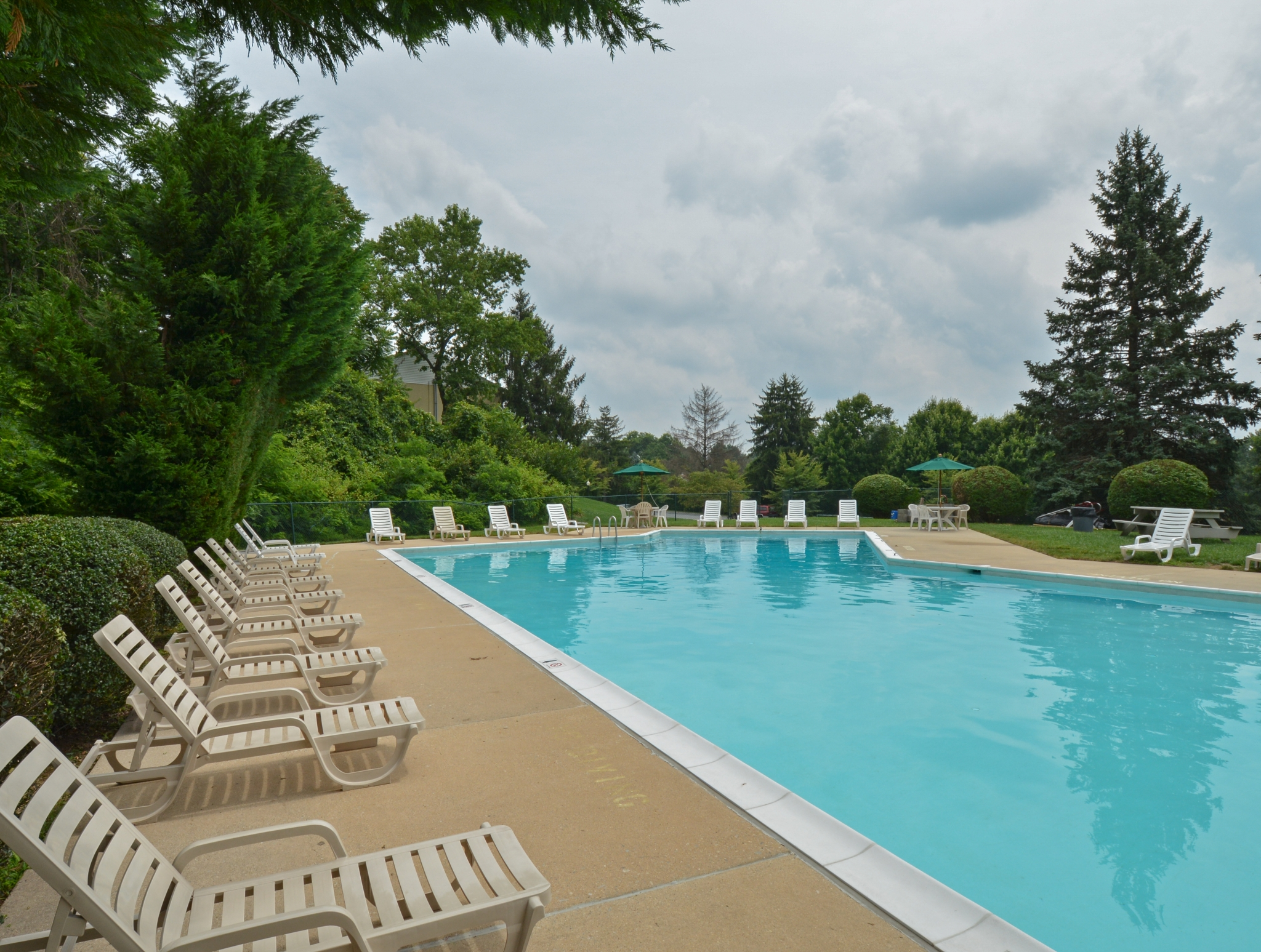 Norwood House Swimming Pool with White Chairs | Apartments In Downingtown