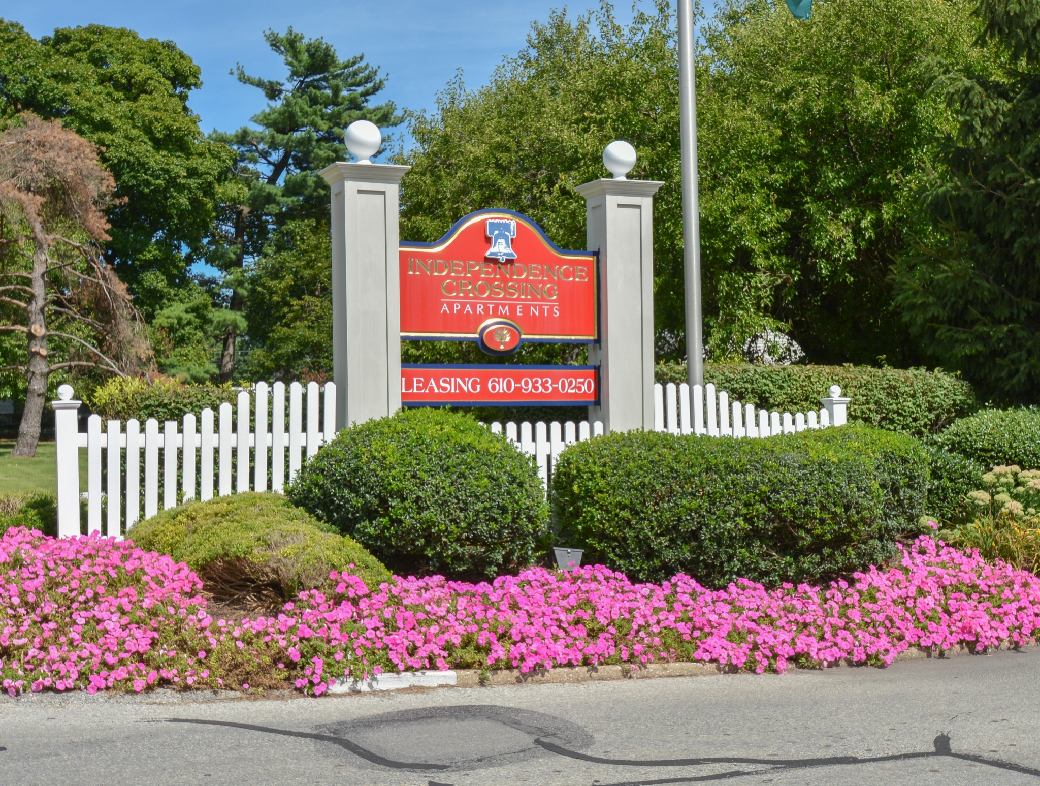 Independence Crossing Red Welcome Sign | Apartments in Phoenixville PA