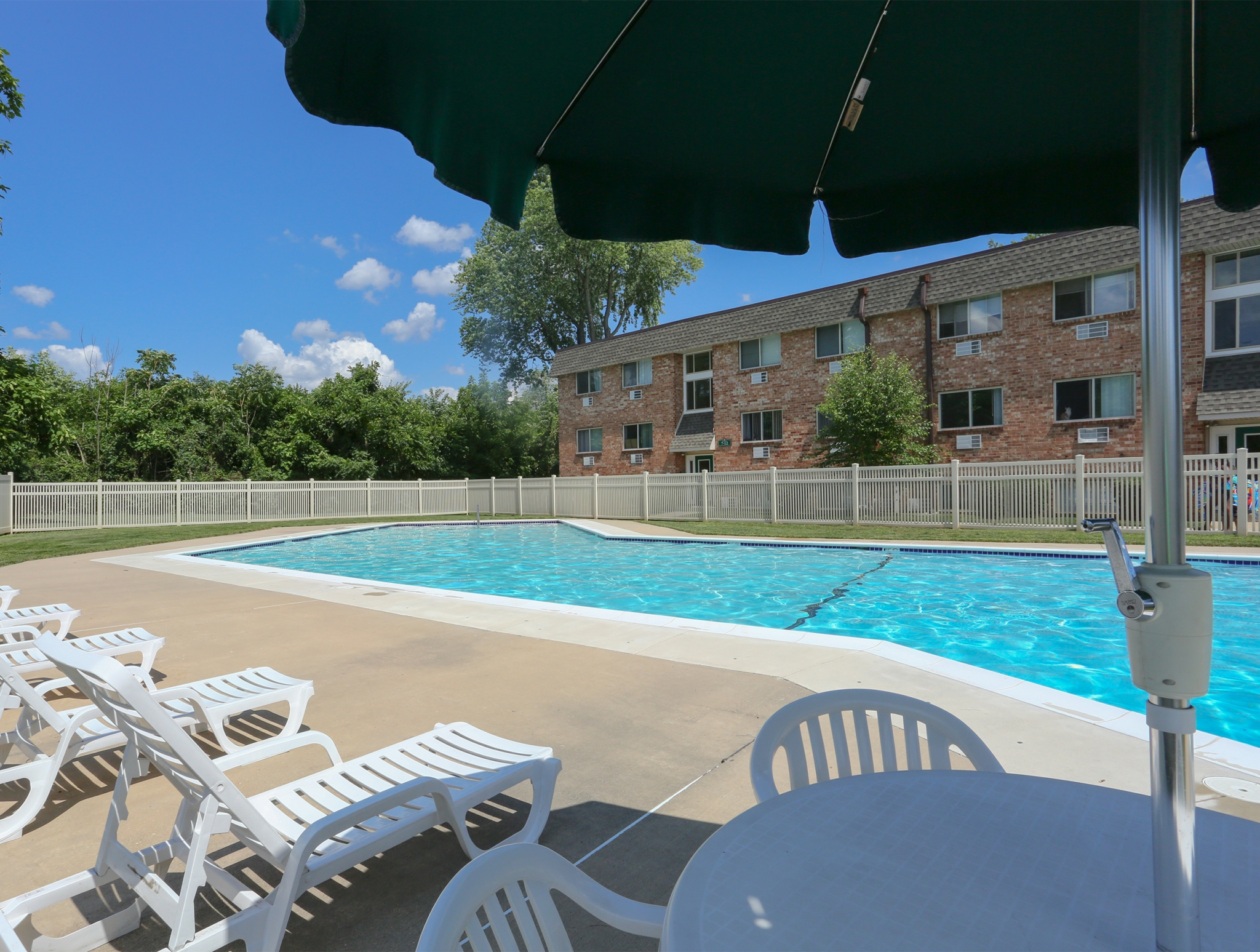 Mill Creek Village Swimming Pool with Umbrella Shade | Langhorne, PA Apartments