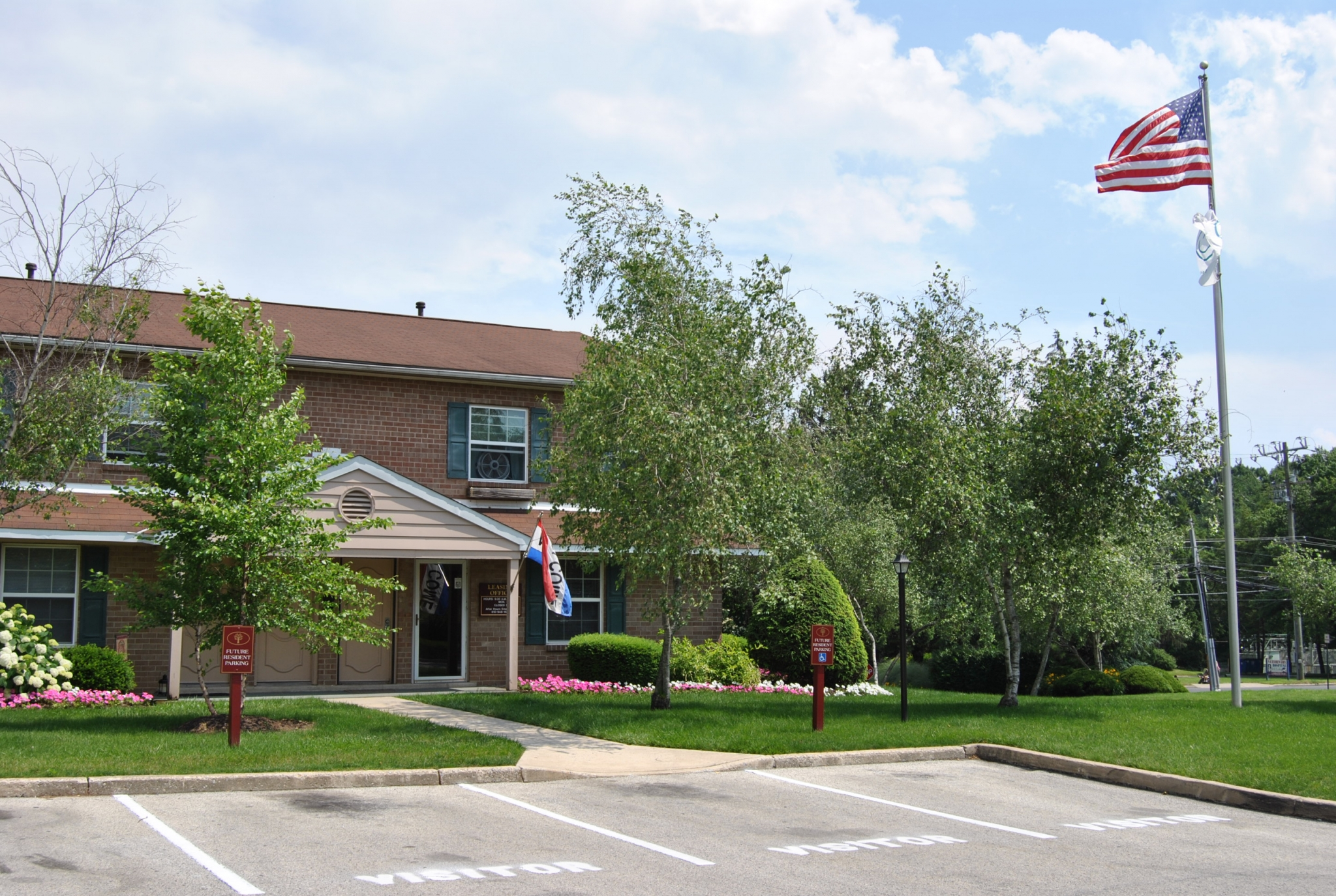 Westover Village Leasing and Management Office with American Flag and Red Signs | Apartments near Norristown, PA