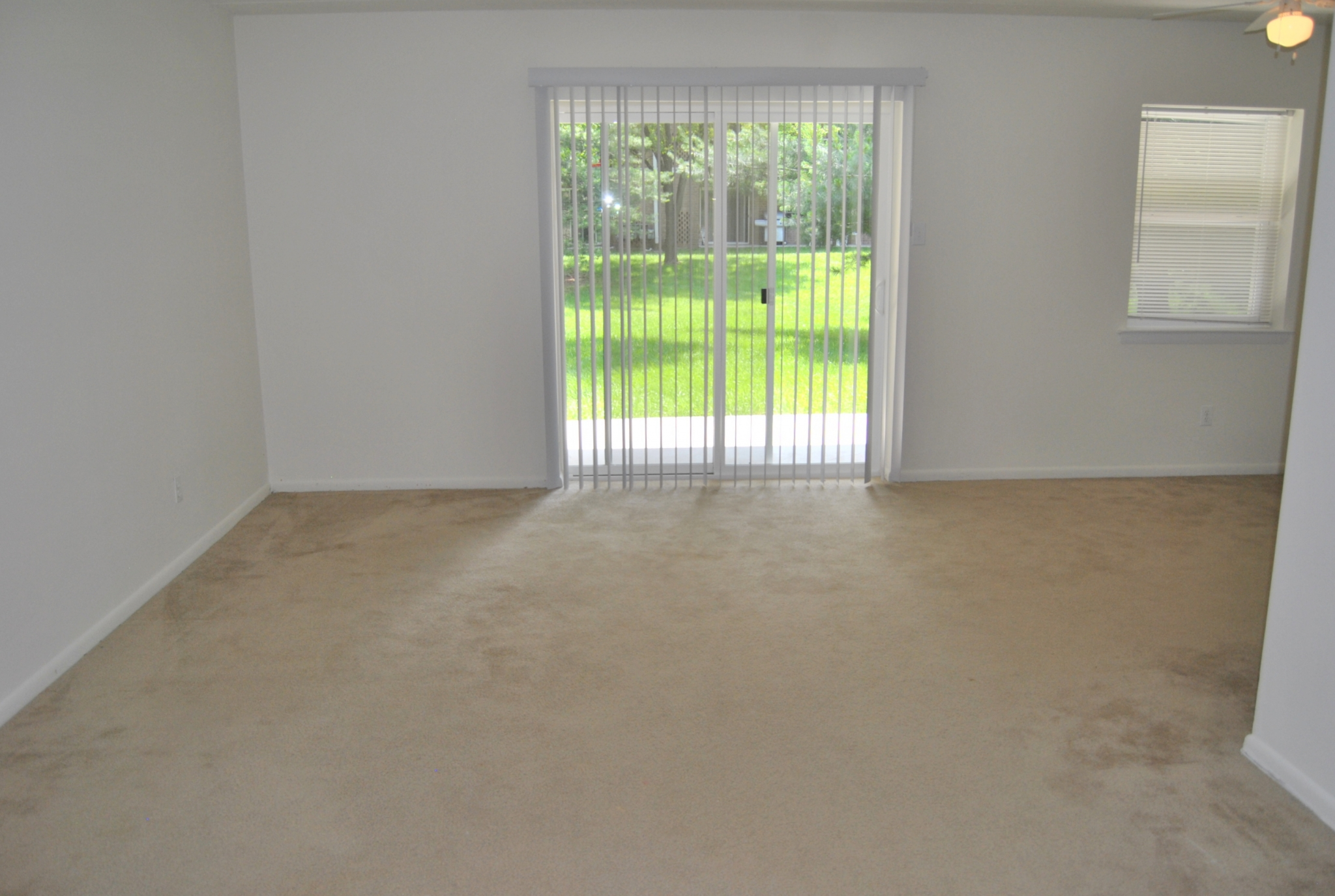Westover Village Sample Living Room with Beige Carpet and Patio Door | Apartments near Norristown, PA