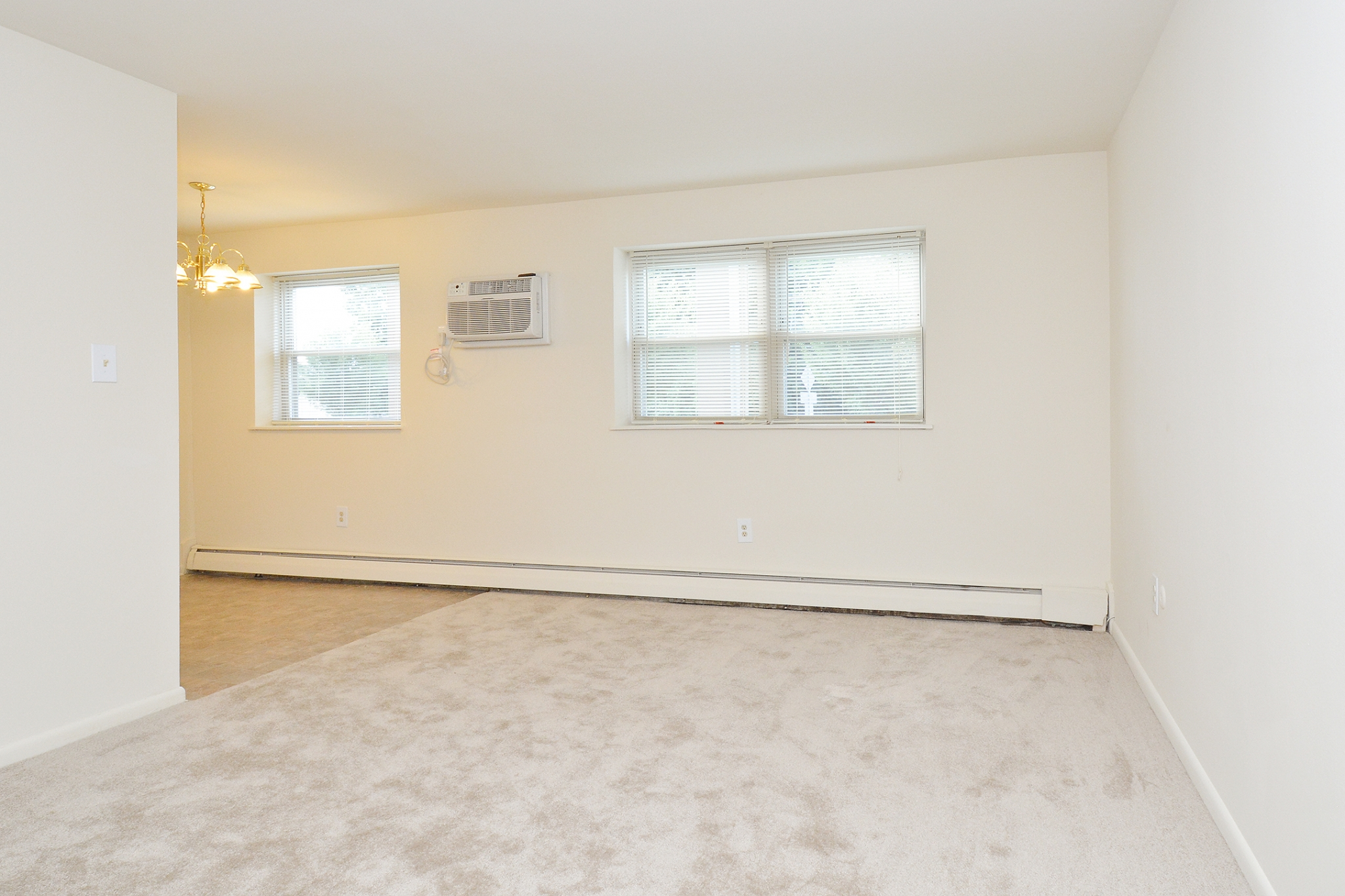 Newport Village Sample Living Room with In-Unit Air Conditioning and Two Windows | Levittown PA Apartments