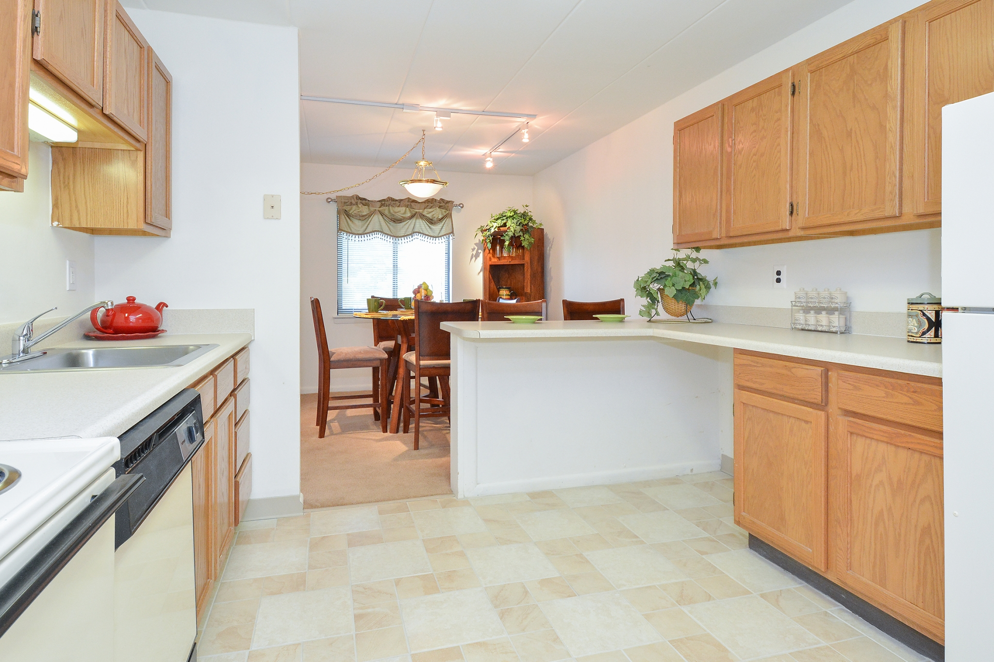 Fairway Park Sample Kitchen with Brown Cabinets and Tiled Floor | Apartments Near Wilmington DE