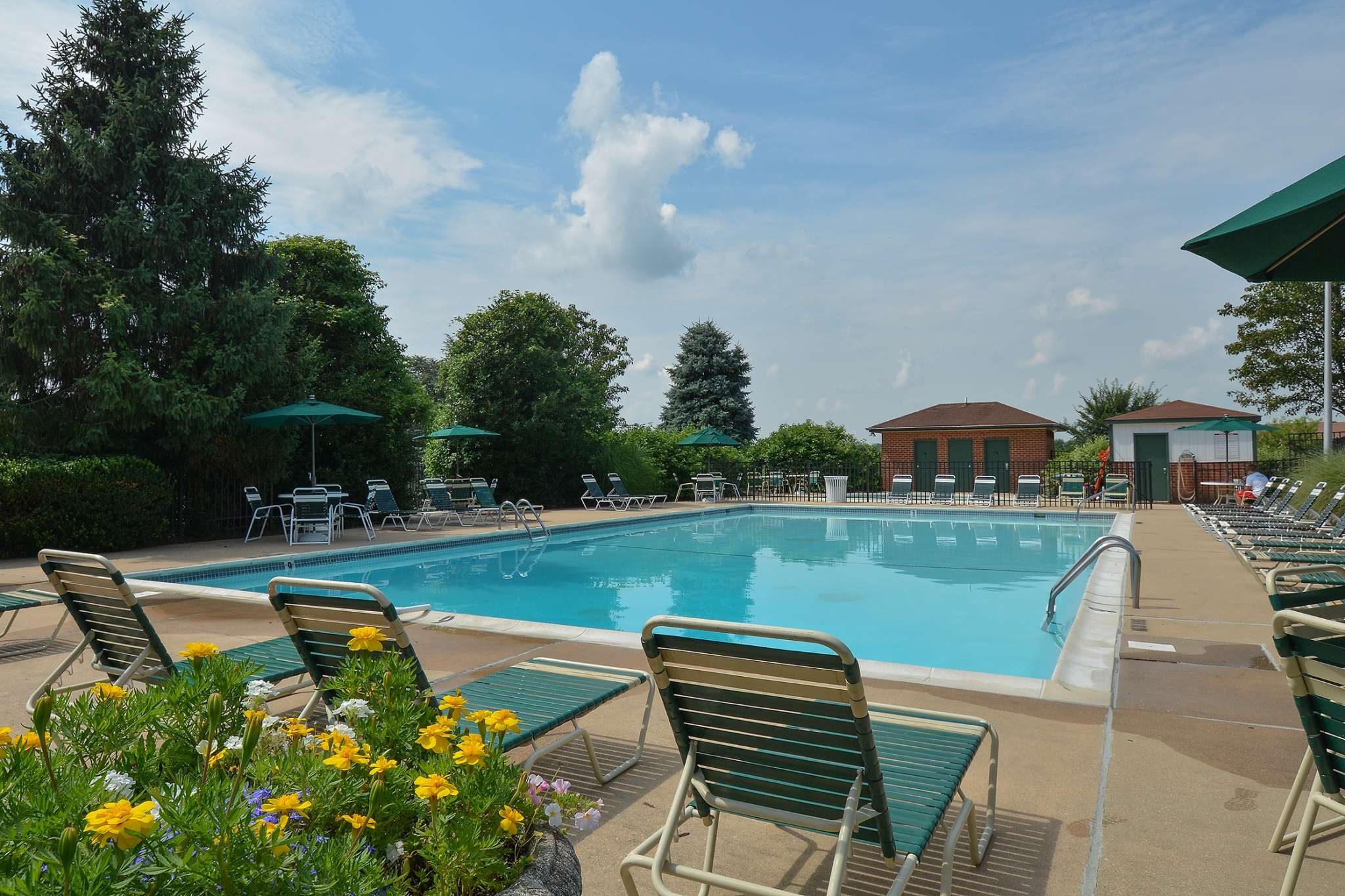 Fairway Park Swimming Pool with Chairs and Yellow Flowers | Apartments Near Wilmington DE