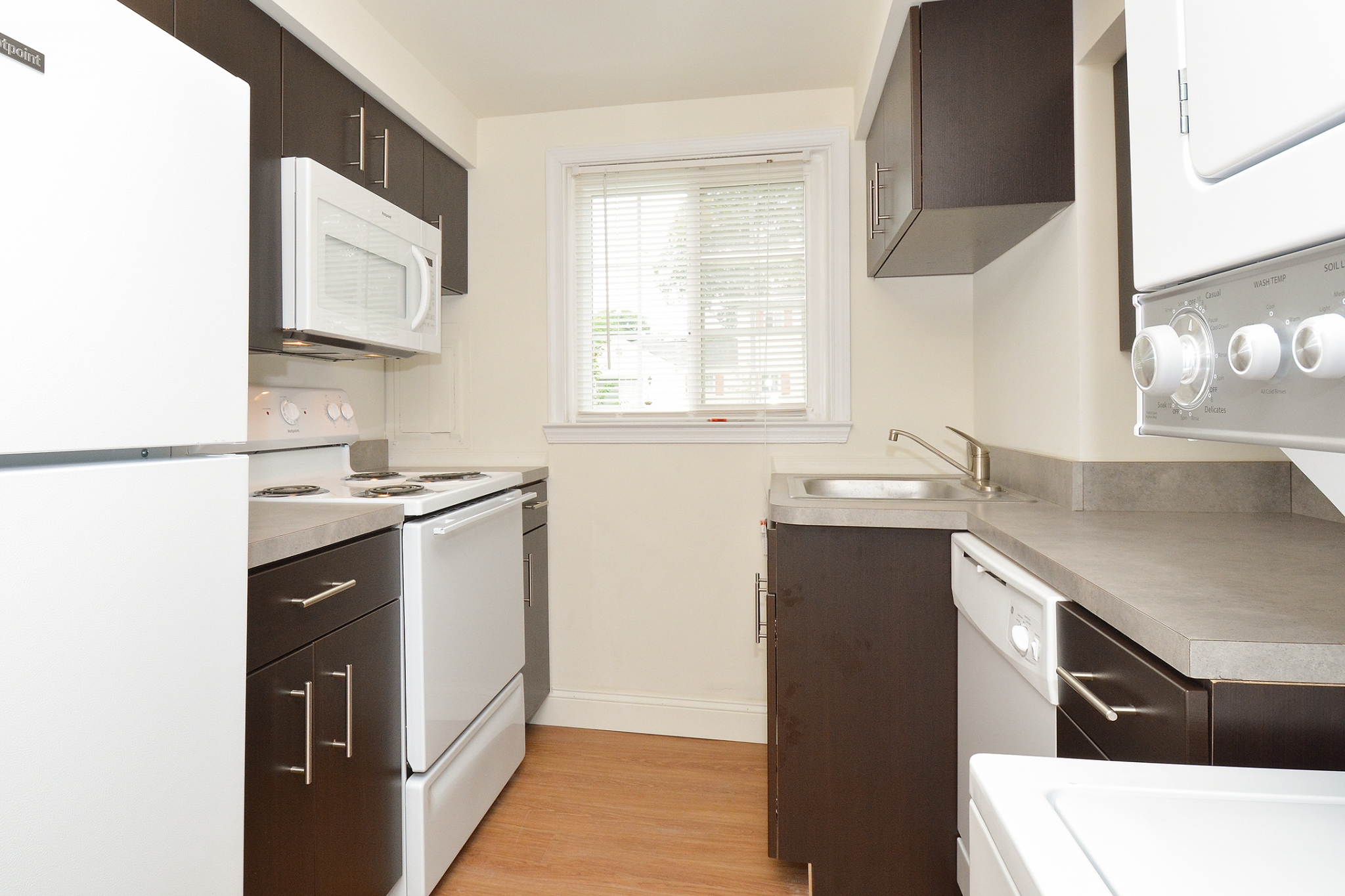 Greenville on 141 Sample Kitchen with Window and Hardwood Floors | Apartments Near Wilmington DE
