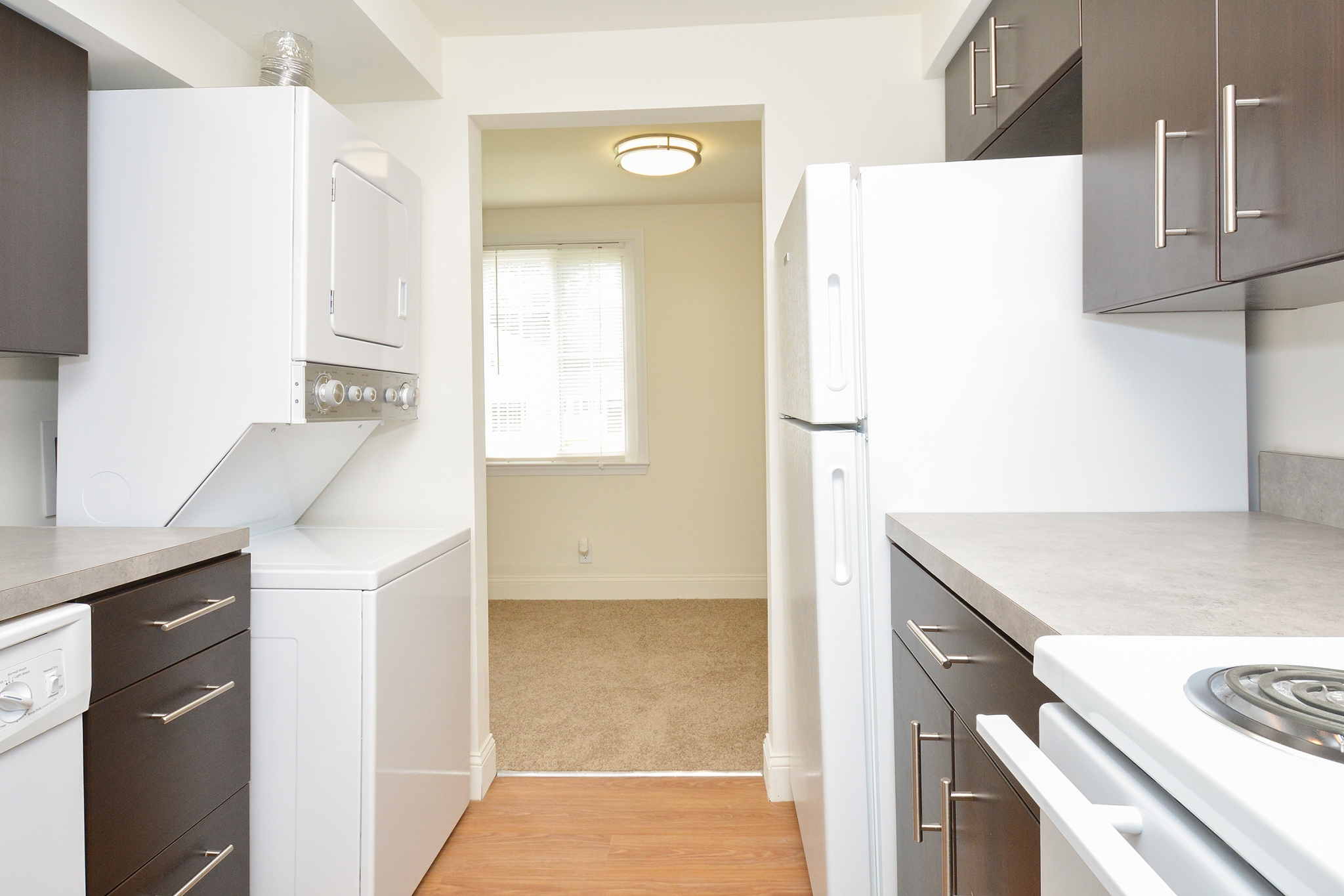 Greenville on 141 Sample Kitchen with Washer and Dryer and Dining Room View | Apartments Near Wilmington DE