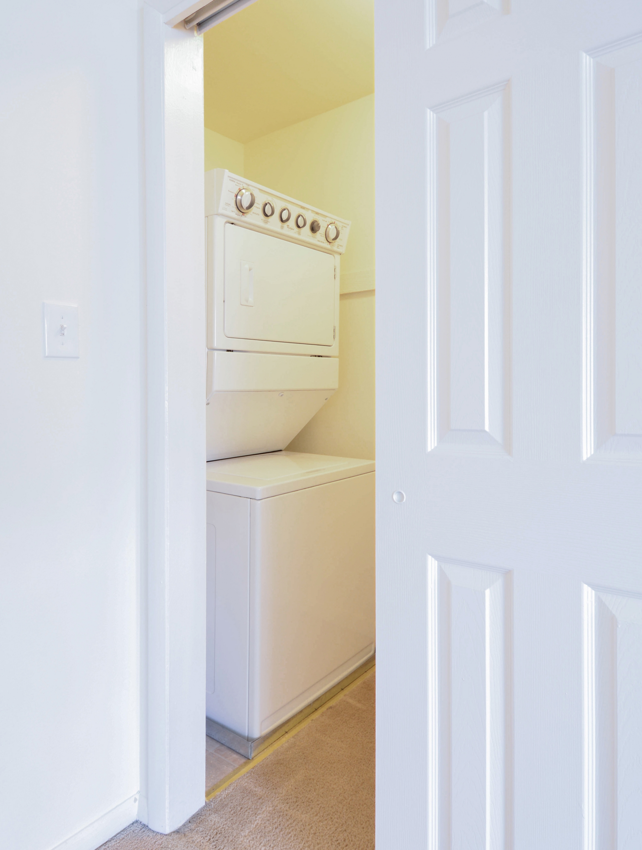 Concord Court Sample Laundry Room with Sliding Door | Aston Apartments