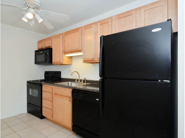 Concord Court Sample Kitchen with Black Appliances | Aston Apartments