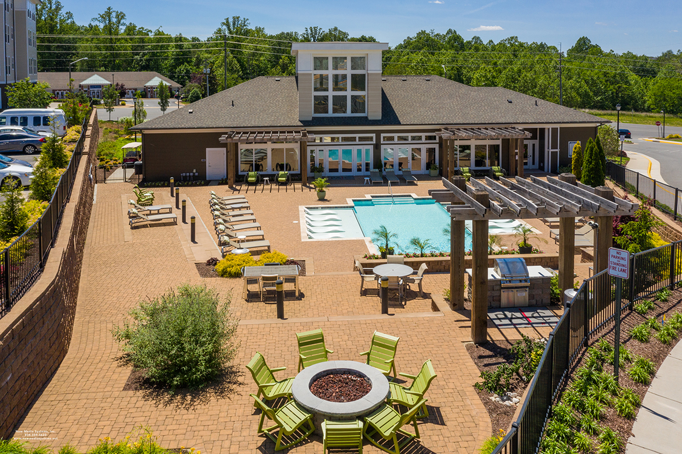 View of courtyard with pool BBQ grill and firepit