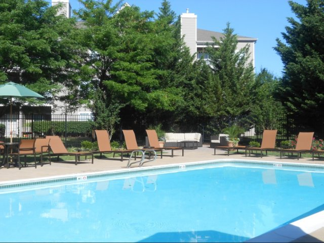 Image of Swimming pool with lounge and seating area for Reserve at Ballenger Creek