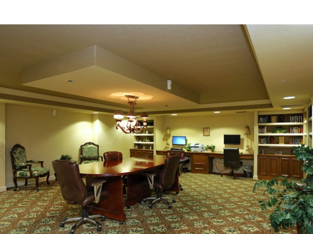 Camino Real, interior, business center, conference table and chairs, computers, printer, book shelves